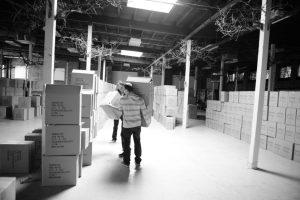Workers Lifting Boxes | TAB Bank, Utah